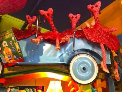 dolls in cars